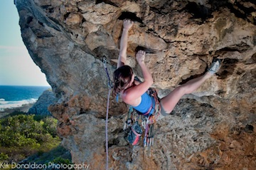 Seaside sport climbing on overhanging limestone caves