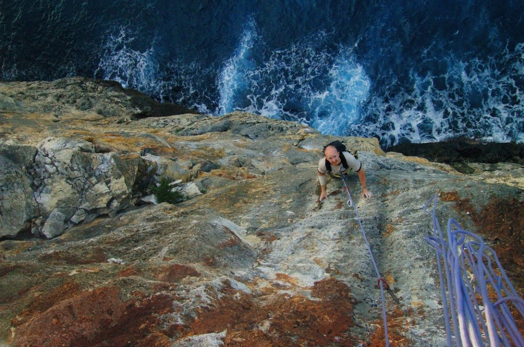 Tropical Rock Climbing over the Caribbean sea. Sea cliff climbing. Tropical rock climbing destination